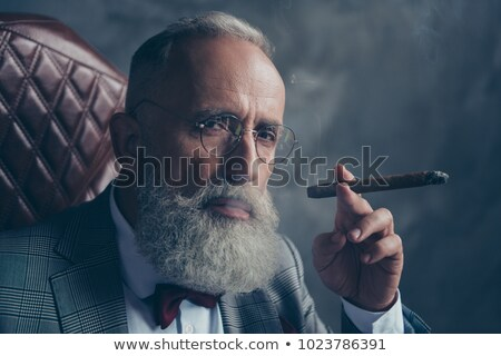Homme fumer cigare blanche maturité Photo stock © stockyimages