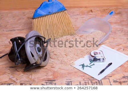handheld circular saw with sawdust and pan stock photo © ozgur