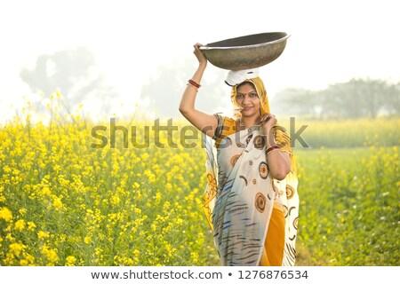 Női gazda megművelt mezőgazdasági mező áll Stock fotó © stevanovicigor