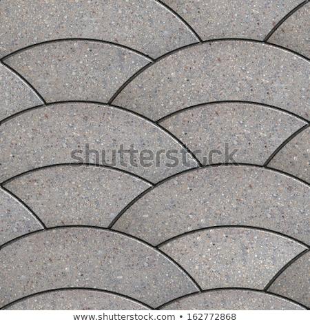 Grey Paving Slabs of the Wavy Form. Stock photo © tashatuvango