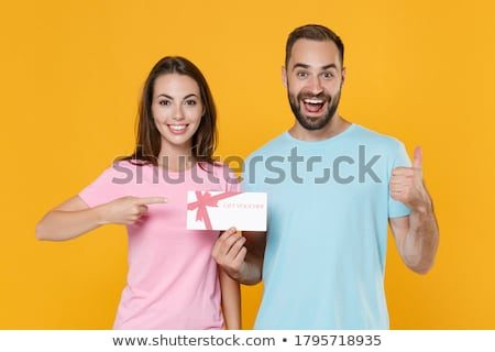 Couple pointing fingers Stock photo © ajfilgud