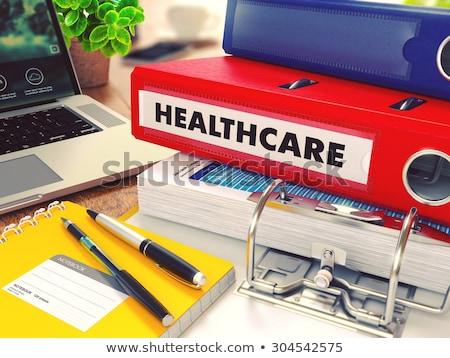 Healthcare on Red Office Folder. Toned Image. Stock photo © tashatuvango