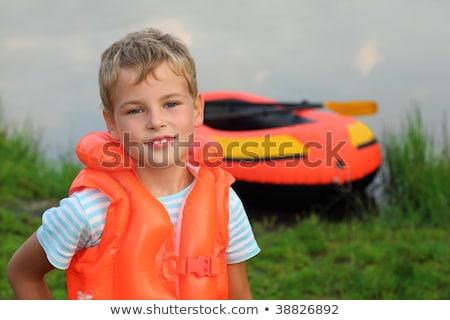 boy and inflatable boat ashore Stock photo © Paha_L