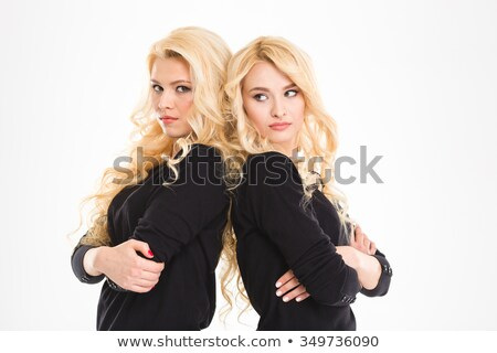 Offended sisters twins Stock photo © deandrobot