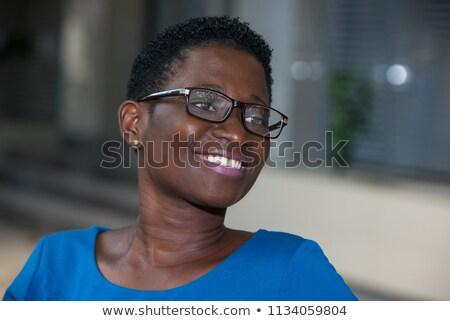 Profil csábító nyugodt fiatal nő rövidnadrág kockás Stock fotó © deandrobot