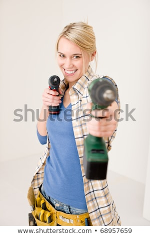 Foto stock: Home Improvement - Woman With Battery Screwdriver