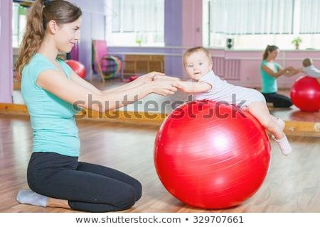 Gyönyörű tornász lány piros labda jelmez Stock fotó © svetography