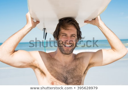 close up portrait of a young surfer with surfboard stock photo © deandrobot