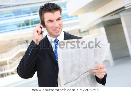 Happy businessman with newspaper Stock photo © deandrobot