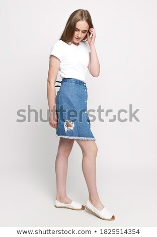 young pretty brunette woman in jeans shorts isolated on white smiling happy, lifestyle people concep Stock photo © iordani