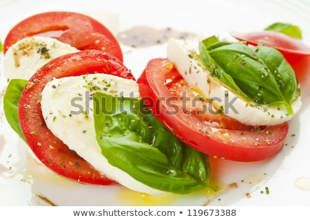 Caprese salad with mozzarella, tomato, basil and balsamic vinega Stock photo © Yatsenko