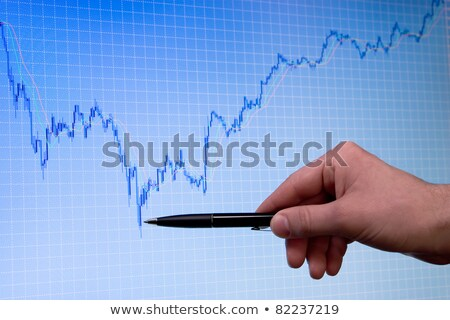 blue growing forex chart on display and hand with pen Stock photo © your_lucky_photo