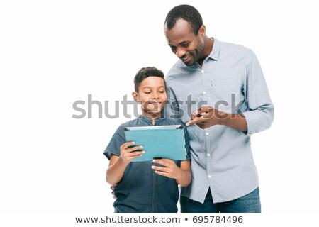 happy family using digital tablet isolated on black stock photo © lightfieldstudios