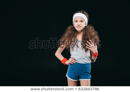 girl posing in sportswear isolated on black 12 year old kids children sport concept stock photo © lightfieldstudios