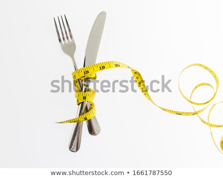 Measuring Tape On Fork Stock photo © Lightsource