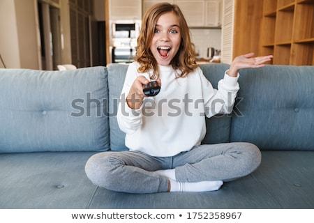 Lány távirányító kanapé pihen otthon gyermek Stock fotó © wavebreak_media
