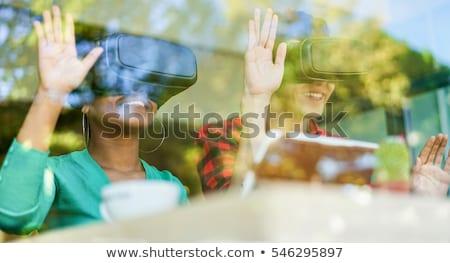 Gelukkig vrienden kijken moderne hoofdtelefoon coffeeshop Stockfoto © DisobeyArt