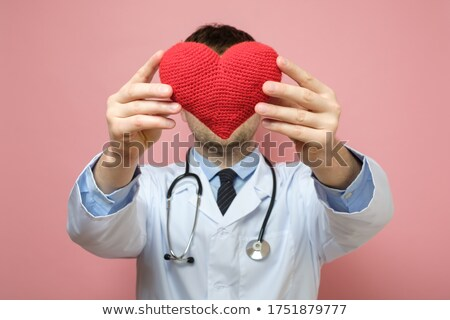 Foto stock: Caucasian Cardiologist Holding A Big Red Heart