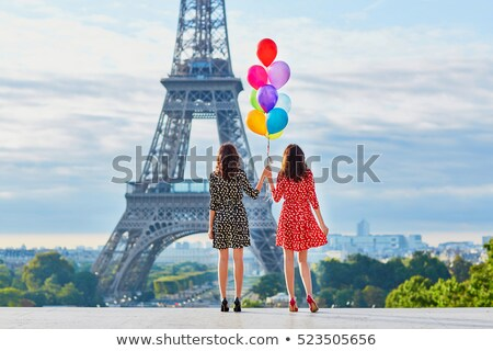 friends in front of eiffel tower stock photo © is2