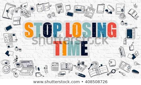 stop losing time concept multicolor on white brickwall stock photo © tashatuvango