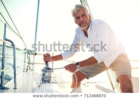 Homem maduro navegação iate homem viajar blue sky Foto stock © IS2
