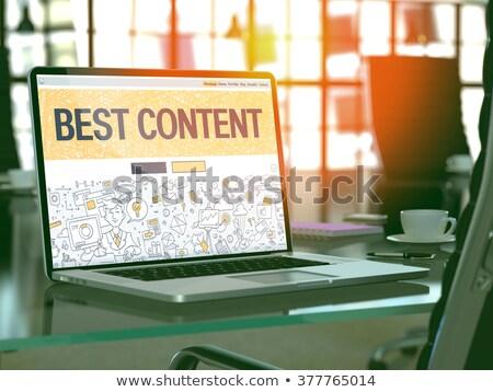 Best Content on Laptop in Modern Workplace Background. Stock photo © tashatuvango