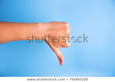 Dislike and disapprove hand gesture with thumb down Stock photo © stevanovicigor