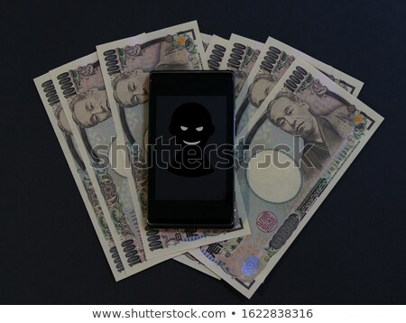 Online hacker steals yen money from computer Stock photo © studiostoks