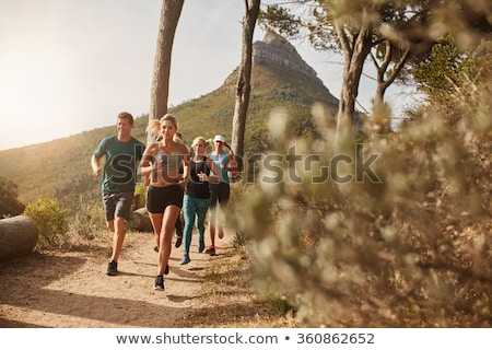 young woman running on country road in mountains summer day stock photo © blasbike
