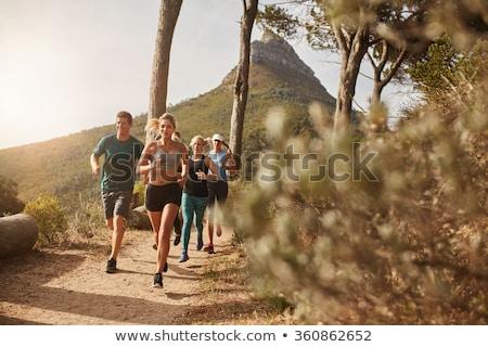 Mulher jovem corrida estrada rural montanhas verão dia Foto stock © blasbike