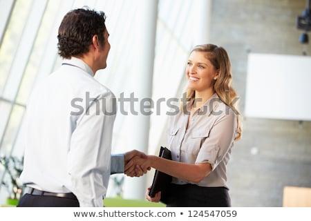 Férfi nő kézfogás üzlet megállapodás kézfogás Stock fotó © stevanovicigor