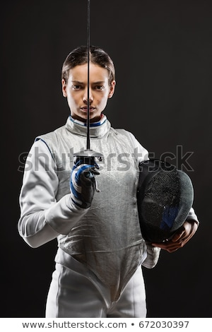 Girl in fencing costume holding sword Stock photo © IS2