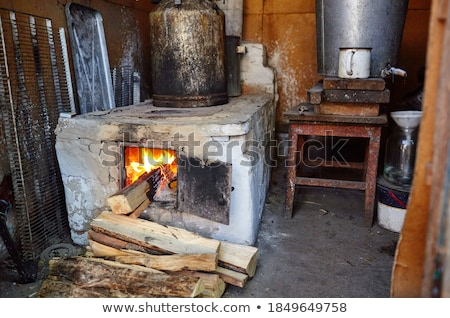 cooking on retro wood fueled stove Stock photo © milsiart