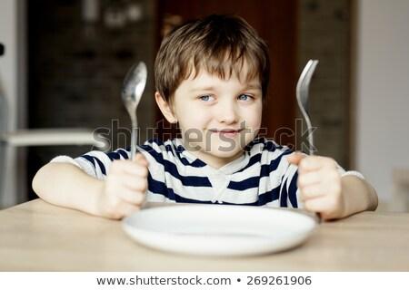 Chłopca czeka posiłek posiedzenia Zdjęcia stock © IS2