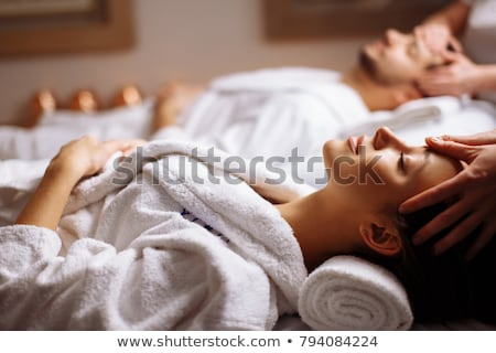 Beautiful young woman relaxing with hand massage at beauty spa Stock photo © dashapetrenko