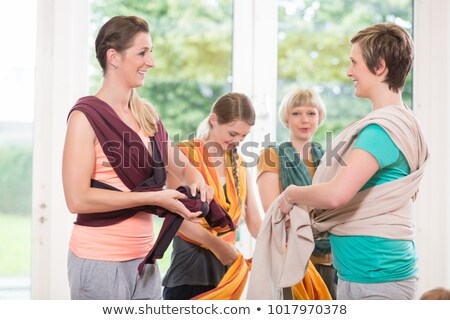 young women learn how to use baby carriers for carrying children stock photo © kzenon
