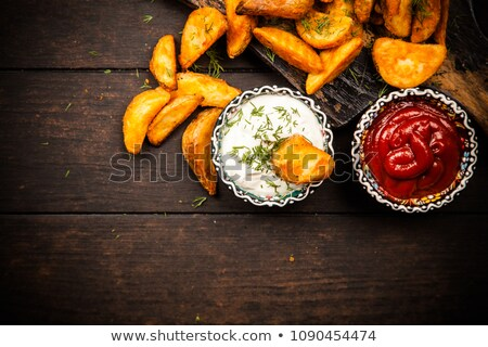 pan of rustic golden french fries Stock photo © zkruger
