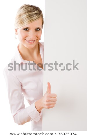 Stock photo: happy businesswoman behind empty banner thumbs up