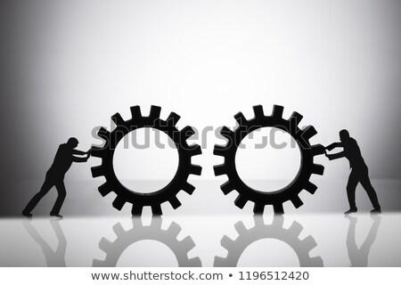 Sziluett kettő üzletemberek sebességváltó tükröződő fém Stock fotó © AndreyPopov