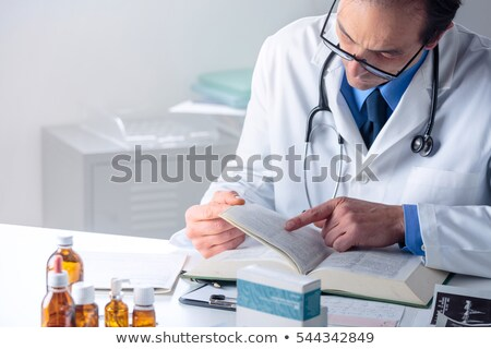 doctor reading a medical report of a senior man Stock photo © nito