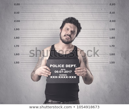 Caught gangster in jail Stock photo © ra2studio