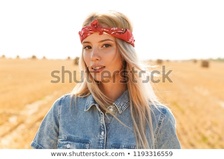 Beautiful young blonde girl in headband at the wheat field Stock photo © deandrobot