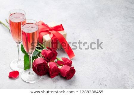 gift box and champagne glasses stock photo © karandaev