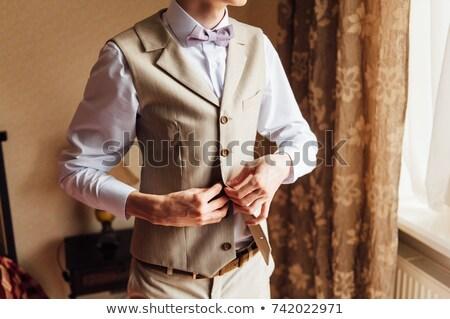 groom wears stylish bow tie using friend Stock photo © ruslanshramko