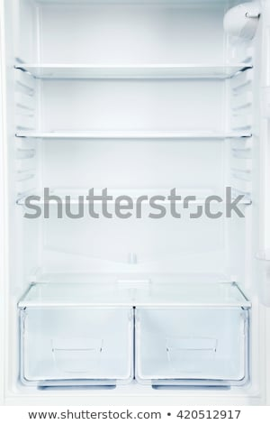 close up of an open refrigerator stock photo © andreypopov