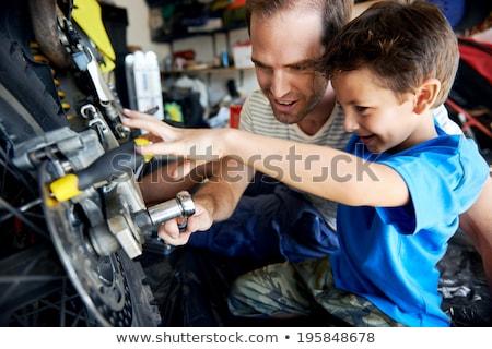 two boys repairing motorcycle stock photo © kzenon