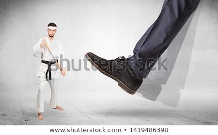 Big foot trample karate trainer concept Stock photo © ra2studio