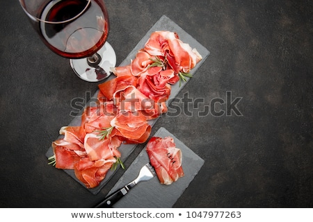 Spanish jamon, prosciutto and wine glass Stok fotoğraf © karandaev