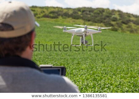 UAV Drone Pilot Flying and Gathering Data Over Country Farm Land Stock photo © feverpitch