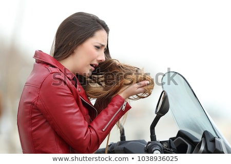 Portrait of a woman complaining about tangled hair. Stock photo © ElenaBatkova